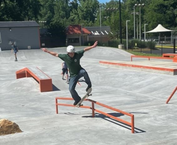 Skateboarder performs a trick on a grind rail on June 7, 2021 at the new Rockville Skate Park.