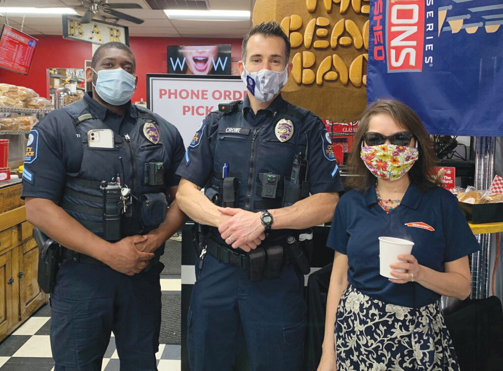 2 officers and patron at coffee shop